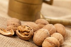 Walnuts laying on jute Stock Photography