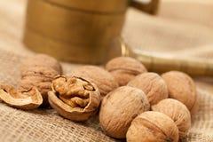 Walnuts laying on jute Stock Photography