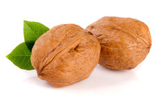 Walnuts with leaf isolated on white background.  Stock Photos
