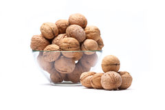 Walnuts Lie In A Glass Bowl Isolated On White Stock Images