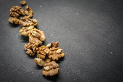 Walnuts. Located on a black plate Stock Photos
