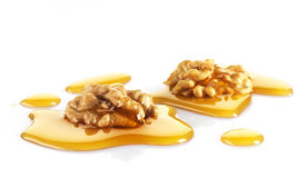 Walnuts and maple syrup royalty free stock photography