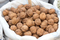 Walnuts on a market. In the sack Royalty Free Stock Photo