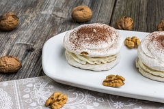 Walnuts Meringue with cocoa with cracking walnuts Royalty Free Stock Photos