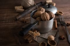 Walnuts in a metal bowl, dark background. Stock Photo