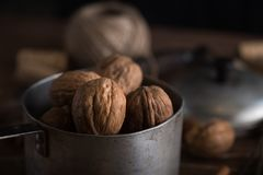 Walnuts in a metal bowl, dark background. Walnuts in a metal bowl, dark background, close-up Royalty Free Stock Photo