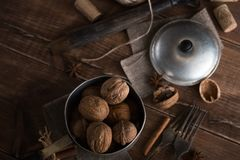 Walnuts in a metal bowl, dark background. Top view Royalty Free Stock Photo
