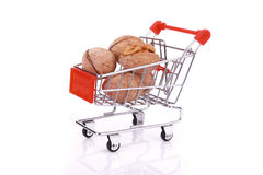 Walnuts in miniature shopping cart isolated Royalty Free Stock Images