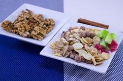 Walnuts, muesli and cinnamon sticks Royalty Free Stock Photography