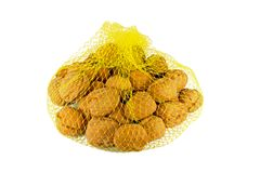 Walnuts in net bag. Isolated on white stock photos