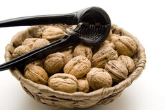 Walnuts with nutcracker Stock Photography