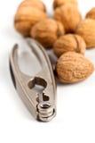 Walnuts and nutcracker Stock Photos