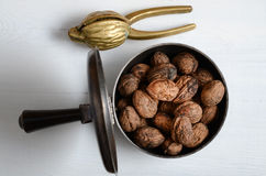 Walnuts and a nutcracker Royalty Free Stock Images