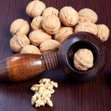 Walnuts and nutcracker close-up Stock Photos