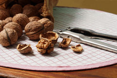 Walnuts and Nutcracker on Table Stock Image