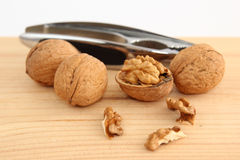 Walnuts and Nutcracker on Wood Royalty Free Stock Images