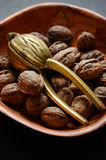 Walnuts and a nutcracker Stock Photography