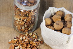 The walnuts nuts vitamins for the brain. The walnuts in shell and peeled kernels stock photo