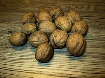 Walnuts on an oak table. royalty free stock photography