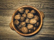 Walnuts on an oak table. stock images