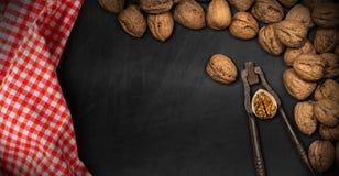 Walnuts with Old Nutcracker on a Blackboard Stock Photos