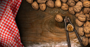 Walnuts with Old Nutcracker - Wooden Background Royalty Free Stock Photo