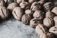 Walnuts. On an old rustic table Stock Photos