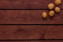 Walnuts on old vintage boards royalty free stock photos