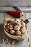 Walnuts in old wooden bowl Stock Photo