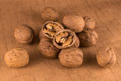 Walnuts opened in brown background stock images