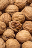 Walnuts with open nut Stock Photos