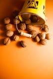 Walnuts on orange background Royalty Free Stock Photos