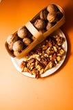 Walnuts on orange background Stock Image