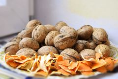 Walnuts and orange peel Stock Images