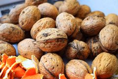 Walnuts and orange peel Royalty Free Stock Photos