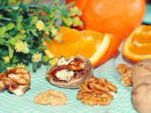 Walnuts with oranges Stock Photos