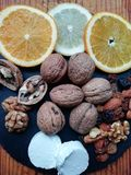 Walnuts and other fruits. Walnuts, orange, lemon and other fruits with goat cheese royalty free stock photography