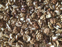 Walnuts pile. A pile of raw walnuts Royalty Free Stock Photos