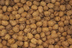 Walnuts. Pile of walnut nuts on an open air fruit and vegetable stall Royalty Free Stock Photo