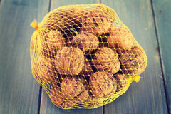 Walnuts in plastic bag Royalty Free Stock Photo
