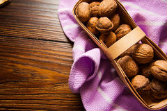 Walnuts on plate with napkin Royalty Free Stock Photos