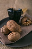 Walnuts on the plate and nutcracker Stock Image