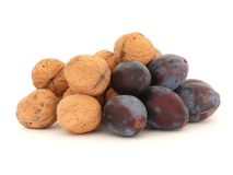 Walnuts and plums Royalty Free Stock Photo