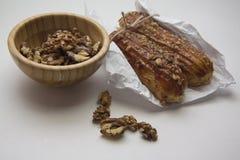 Walnuts and puff buns Stock Image