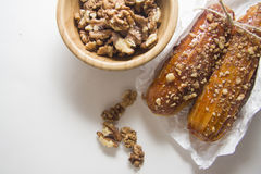 Walnuts and puff buns Stock Photo