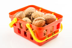 Walnuts in red basket Stock Photography