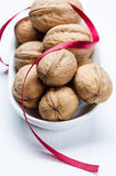 Walnuts and ribbon Royalty Free Stock Photo