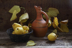 Walnuts, ripe pears and branch of a linden with yellow leaves Royalty Free Stock Image