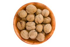 Walnuts in round wooden plate. Stock Images