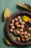 Walnuts in rustic bowl Stock Photography